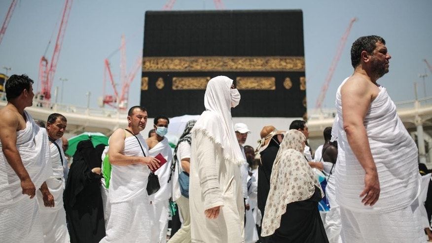Muslim pilgrims circle the Kaaba, the cubic building at the Grand Mosque in the Muslim holy city of Mecca, Saudi Arabia, Tuesday, Sept. 22, 2015. More than 2 million Muslims have begun the first rites of the annual hajj pilgrimage, which draws people from around the world to Mecca and areas around it to perform a series of rituals and prayers aimed at ultimately erasing past sins. (AP Photo/Mosa'ab Elshamy)