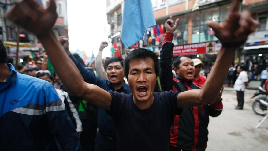 A Nepalese man shouts slogans against the government and the country's new constitution during the protest organized by splinter of the Maoist party, alliance of ethnic group and Madhesi party, in Kathmandu, Nepal, Monday, Sept. 21,2015. Nepal on Sunday, Sept. 20, 2015, formally adopted a much anticipated and long-delayed constitution that took more than seven years to complete following a decade of political infighting. However, security was stepped up across the nation, with smaller political parties and ethnic groups opposing to the new charter and fighting for equal representation in the country's political structure, which according to them has failed to meet their aspirations. (AP Photo/Niranjan Shrestha)