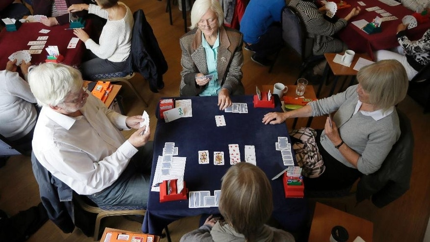 Competitors play bridge at the Acol Bridge Club in West Hampstead, London, Tuesday Sept. 22, 2015. A British judge has been asked to resolve the question of whether bridge is a sport after Sport England ruled that the popular card game is not. The decision is being challenged in Britain's High Court by the English Bridge Union. (AP Photo/Tim Ireland)
