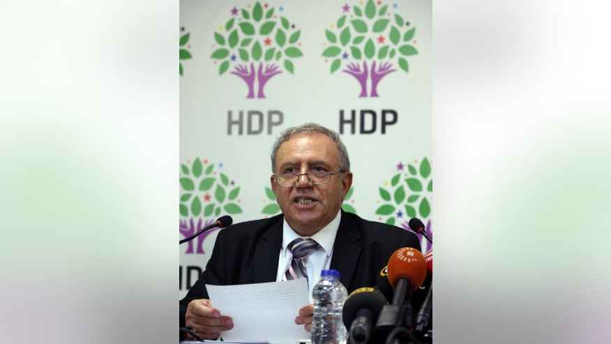 Turkey's Minister for EU Affairs Ali Haydar Konca, a member of the of the pro-Kurdish People's Democracy Party, or HDP, announces his resignation with Development Minister Muslum Dogan in Ankara, Turkey, Tuesday, Sept. 22,  2015. Konca and uslum Dogan  lawmakers from Turkey's pro-Kurdish party  resigned from the interim government amid continued fighting between Kurdish rebels and government forces in the country's southeast. A statement from the prime minister's office said Tuesday that Konca and Dogan had resigned but gave no reason for their decisions.(AP Photo/Burhan Ozbilici)