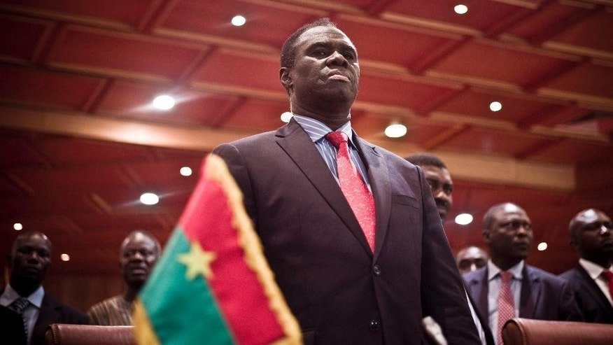 Burkina Faso's transitional president Michel Kafando attends the official handover ceremony returning him to office in Ouagadougou, Burkina Faso, Wednesday, Sept. 23, 2015. Amid cheers and the national anthem, Burkina Faso's interim president took charge of the country again Wednesday a week after a military general and his supporters overthrew him and his transitional government. Interim President Michel Kafando and Prime Minister Yacouba Isaac Zida marked their return to power in an official handover ceremony in Ouagadougou. (AP Photo)