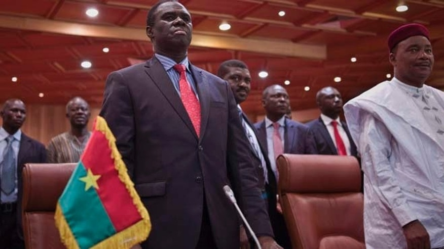 Sept. 23, 2015: Burkina Faso's transitional president Michel Kafando, left, next to Niger's President, Mahamadou Issoufou, right, during a official handover ceremony  in Ouagadougou, Burkina Faso.