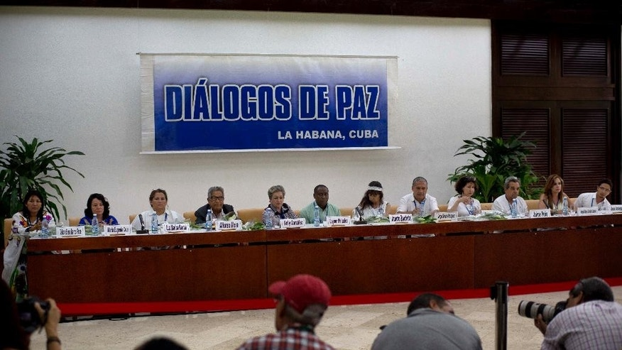 """FILE - In this Aug. 16, 2014 file photo, victims of the Colombian armed conflict give a press conference after a meeting with the peace negotiation teams of the Revolutionary Armed Forces of Colombia (FARC) and Colombia's government on the sidelines of peace talks in Havana, Cuba. Declaring that """"peace is near,"""" Colombia's President Juan Manuel Santos announced a surprise trip Wednesday, Sept. 23, 2015 to Cuba for a key meeting with government negotiators and the rebels' top military commander as he seeks to wrap up talks to end the country's long-running conflict. (AP Photo/Ramon Espinosa, File)"""