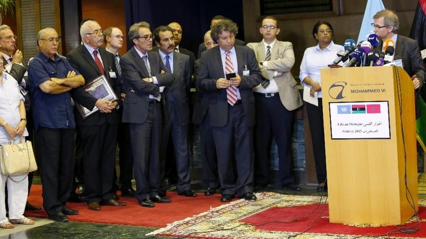 U.N. representative for Libya, Bernardino Leon, right, gestures as he addresses reporters and ambassadors in Skhirat, Morocco, Monday, Sept. 21, 2015. U.N. envoy Leon announced late Monday that the Libyan peace talks are completed and an agreement will be presented to all parties for signing after the Eid al-Adha holiday. At left in white is U.S. ambassador to Libya Deborah K. Jones. (AP Photo/Abdeljalil Bounhar)
