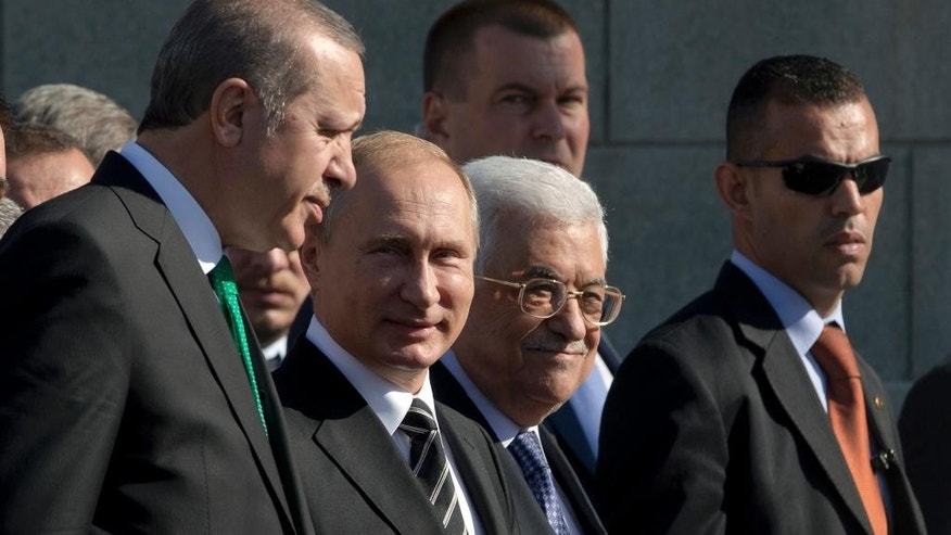 Turkey's President Recep Tayyip Erdogan, left, Russian President Vladimir Putin, second left, and Palestinian President Mahmoud Abbas, third left, walk together to take part in the re-opening ceremony of the newly restored Moscow Cathedral Mosque in Moscow, Russia, Wednesday, Sept.  23, 2015. (AP Photo/Pavel Golovkin)