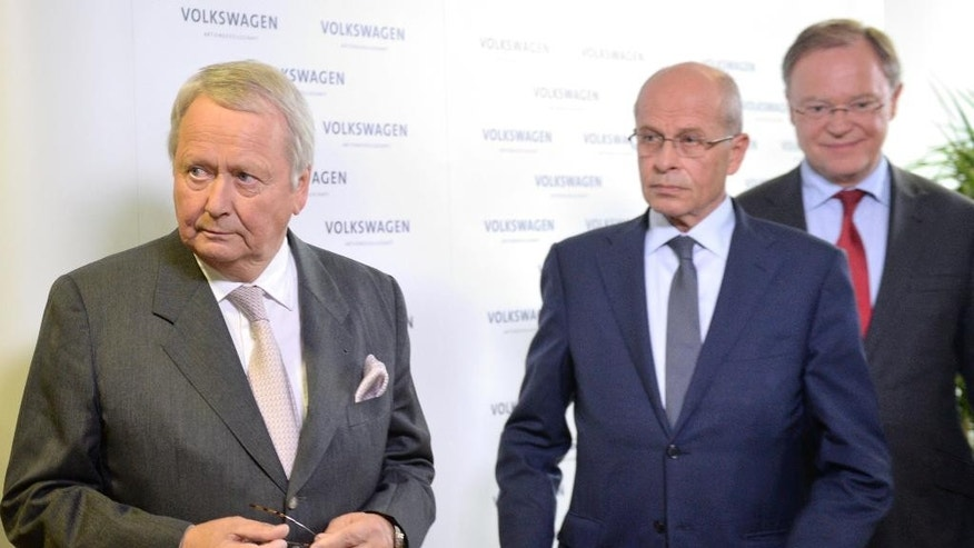 Volkswagen supervisory board member Wolfgang Porsche, acting supervisory board head Berthold Huber, and Stephan Weil, governor of Lower Saxony and member of the supervisory board, from left, leave after a statement announcing that CEO Martin Winterkorn stepped down amid an emissions scandal in the company's headquarters in Wolfsburg, Germany, Wednesday, Sept. 23, 2015. (Julian Stratenschulte/dpa via AP)