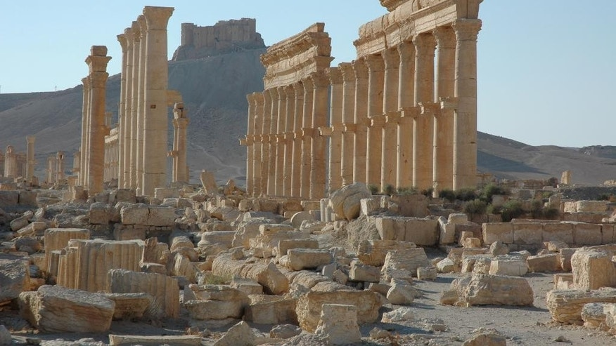 FILE - This undated file image released by UNESCO shows the site of the ancient city of Palmyra in Syria. A satellite image on Aug. 31, 2015 shows that the main building of the ancient Temple of Bel in Palmyra has been destroyed, a United Nations agency said. Experts, conservators and local residents are scrambling to document Syria's millennia-long cultural heritage that has been damaged by the country's war since 2011, by battles against the Islamic State group and by its intentional destruction. (Ron Van Oers/UNESCO via AP, File)