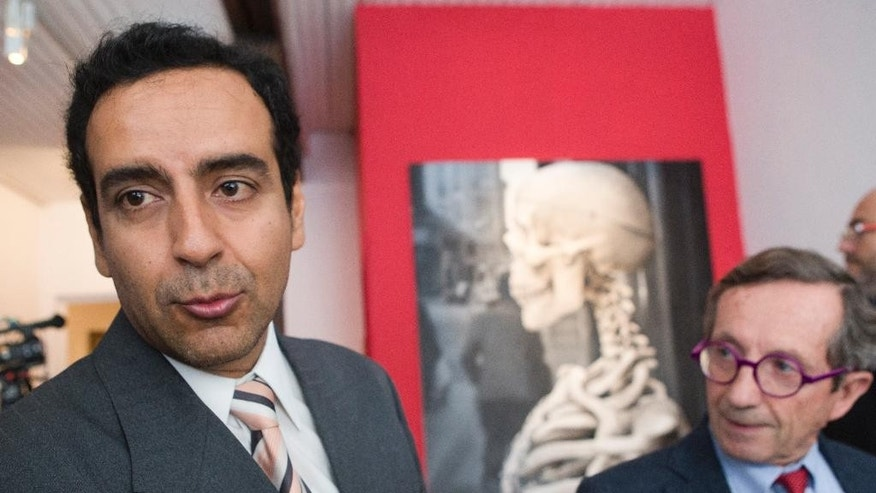 Mexican archeologist  Alexandro Basptistau , left  and French's research director of  archeology Dominique Michelet  answer reporters at the Mexican Cultural institute of Paris, France, Thursday, Sept. 24, 2015. A 2-meter-high, several thousand-year-old sculpture is handed to Mexican authorities 45 years after it disappeared from Mexico. The Olmec stella was recently re-discovered France. (AP Photo/Jacques Brinon)