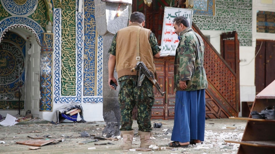 Sept. 24, 2015: Shiite fighters, known as Houthis inspect the inside of the al-Balili mosque after two suicide bombings at the mosque during Eid al-Adha prayers in Sanaa, Yemen.