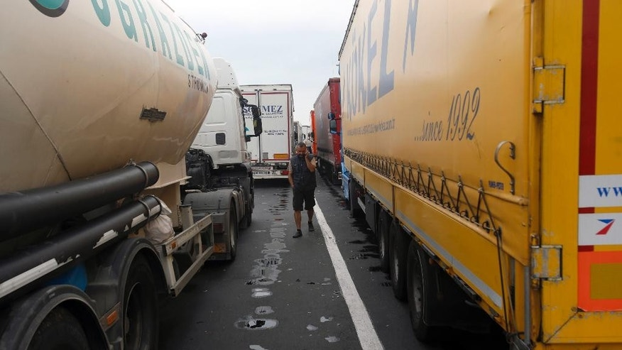 A long queue of vehicles waits on no man's land at the Batrovci border crossing between Serbia and Croatia near Batrovci, about 100 km west from Belgrade, Serbia, Thursday, Sept. 24, 2015. Tensions escalated between Serbia and Croatia on Thursday as the long-time foes struggled to come up with a coherent way to deal with tens of thousands of migrants streaming through the Balkan nations to seek sanctuary in other parts of Europe. (AP Photo/Darko Vojinovic)