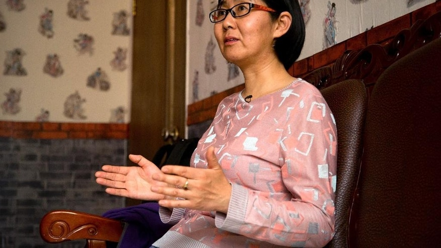 In this April 18, 2015 photo, Chinese lawyer Wang Yu speaks during an interview in Beijing. Chinese leader Xi Jinping will preside Sunday, Sept. 27, 2015 over a U.N. conference on gender equality, 20 years after Beijing held a groundbreaking U.N. conference on women's rights. China has made some progress in women's rights since then, but any improvement on that front was marred by the detentions of five young women known as China's Feminist Five. Wang, a lawyer who represented one of the Feminist Five, has not been seen since early July when police took her away from her apartment. (AP Photo/Mark Schiefelbein)