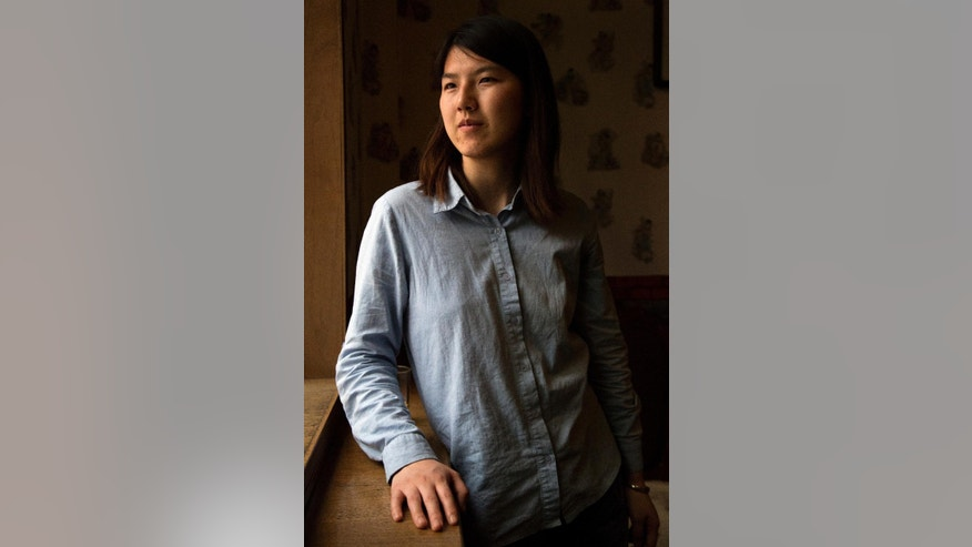 In this April 18, 2015 photo, Chinese feminist activist Li Tingting poses for a portrait in Beijing. Chinese leader Xi Jinping will preside Sunday, Sept. 27, 2015 over a U.N. conference on gender equality, 20 years after Beijing held a groundbreaking U.N. conference on women's rights. China has made some progress in women's rights since then, but any improvement on that front was marred by the detentions of five young women known as China's Feminist Five. Li, one of the five, was released after 37 days but remains a criminal suspect. (AP Photo/Mark Schiefelbein)