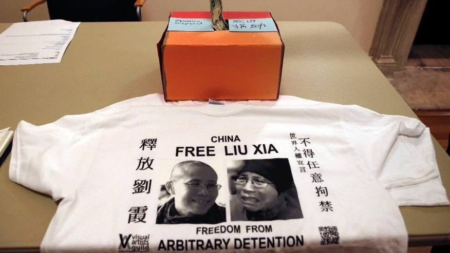 "In this Jan. 14, 2014 file photo, a supporter donates money at an event where Chinese and American writers pushed for the release from house arrest of Liu Xia, the detained wife of Chinese Nobel Peace laureate Liu Xiaobo, in New York. Chinese leader Xi Jinping will preside Sunday, Sept. 27, 2015 over a U.N. conference on gender equality, 20 years after Beijing held a groundbreaking U.N. conference on women's rights. American Ambassador to the U.N. Samantha Power recently cited Liu Xia and two other women in China as examples of political prisoners who have been ""unjustly locked up."" (AP Photo/Kathy Willens, File)"