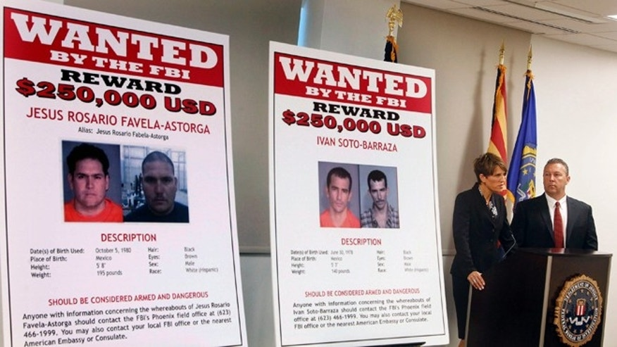 FILE - In this July 9, 2012, file photo, with wanted posters off to the side, Laura E. Duffy, United States Attorney Southern District of California, and FBI Special Agent in Charge, James L. Turgal, Jr., right, announce the indictments on five suspects involved in the death of U.S. Border Patrol agent Brian Terry in Tucson, Ariz. Two men charged with murder in the death of a U.S. Border Patrol agent that revealed the bungled gun-smuggling investigation known as Fast and Furious go on trial Wednesday, Sept. 23, 2015. Jesus Leonel Sanchez-Meza, also known as Lionel Portillo-Meza, and Ivan Soto-Barraza will be the first to face trial. (AP Photo/Ross D. Franklin, File)