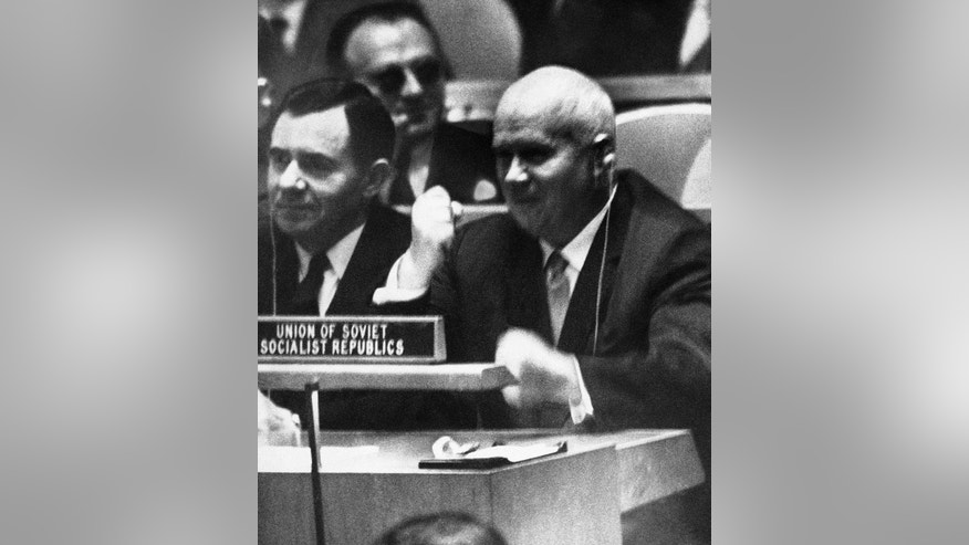 FILE - In this Oct. 12, 1960 file photo, Soviet Premier Nikita Khrushchev pounds his desk at the United Nations with his fist  during a General Assembly debate on colonialism at the UN. His wrist watch, on the desk in front of him, came off during his angry response, before he began using a shoe to pound the desk. As the meeting place for all the world's nations and their leaders celebrates its 70th anniversary, that address is one many memorable moments in the history of the General Assembly. (AP Photo, File)