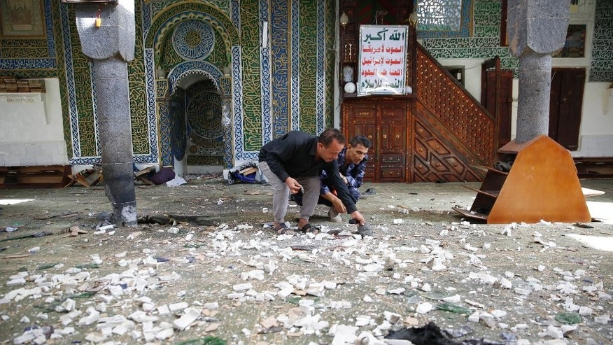 Police inspect inside the al-Balili mosque after two suicide bombings at the mosque during Eid al-Adha prayers in Sanaa, Yemen, Thursday, Sept. 24, 2015. (AP Photo/Hani Mohammed)