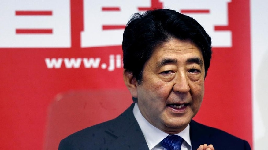 Japanese Prime Minister Shinzo Abe delivers a speech during a press conference at the headquarters of his ruling Liberal Democratic Party in Tokyo, Thursday, Sept. 24, 2015.  Prime Minister Abe, fresh from a bruising battle over unpopular military legislation, announced Thursday an updated plan for reviving the world's third-largest economy, setting a GDP target of 600 trillion yen ($5 trillion).(AP Photo/Shuji Kajiyama)