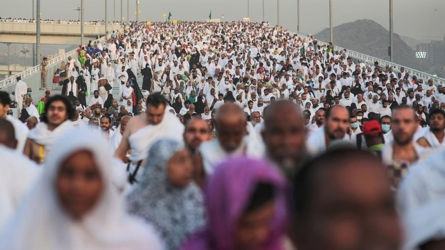"Hundreds of thousands of Muslim pilgrims make their way to cast stones at a pillar symbolizing the stoning of Satan, in a ritual called ""Jamarat,"" the last rite of the annual hajj, on the first day of Eid al-Adha, in Mina near the holy city of Mecca, Saudi Arabia, Thursday, Sept. 24, 2015. (AP Photo/Mosa'ab Elshamy)"