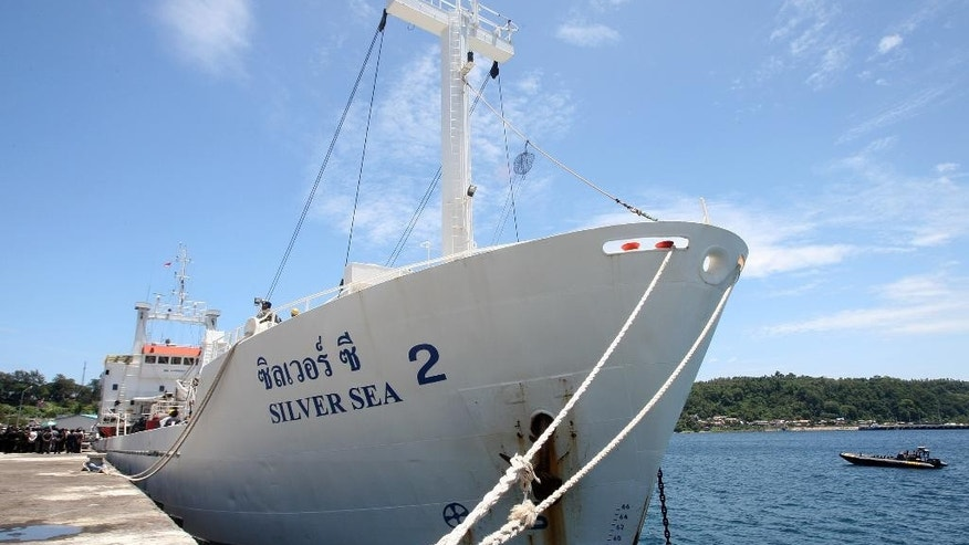 CORRECTS THE NUMBER OF THAIS ARRESTED TO ONE (THE SHIP'S CAPTAIN), INSTEAD OF THREE - Silver Sea 2, a Thai-owned cargo ship which was seized by Indonesian authorities last August, is docked at the port of Sabang, Aceh province, Indonesia, Friday, Sept. 25, 2015. The Thai captain of the ship has been arrested in Indonesia following allegations of illegal fishing, an official said Friday. It is the latest development linked to an Associated Press investigation that uncovered a slave island earlier this year. (AP Photo/Heri Juanda)