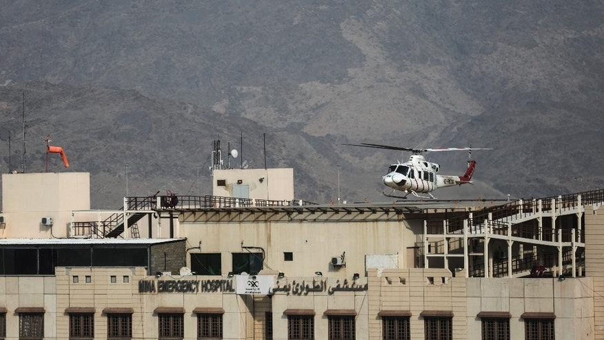 An ambulance helicopter lands atop a hospital next to the site where pilgrims were crushed and trampled to death during the annual hajj pilgrimage in Mina, Saudi Arabia, Thursday, Sept. 24, 2015. The crush killed hundreds of pilgrims and injured hundreds more in Mina, a large valley on the outskirts of the holy city of Mecca, the deadliest tragedy to strike the pilgrimage in more than two decades. (AP Photo/Mosa'ab Elshamy)