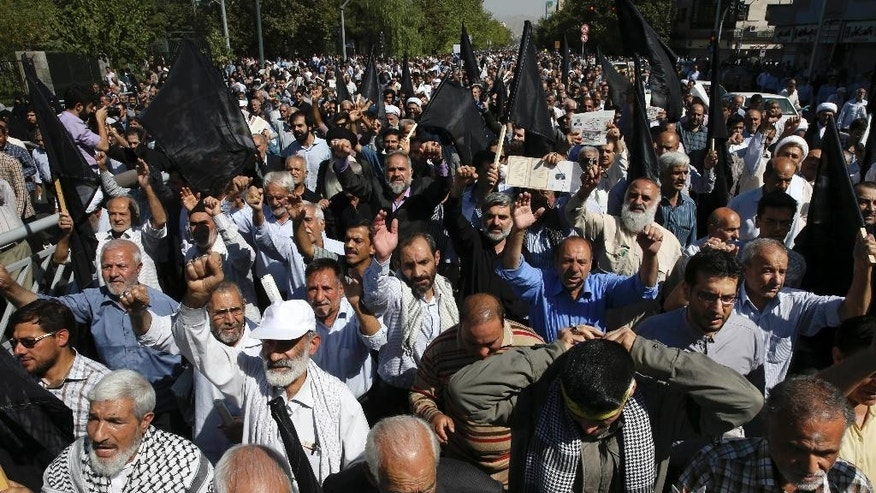 "Iranian worshippers attend an anti-Saudi protest rally on Thursday, after their Friday prayer service in Tehran, Iran, Friday, Sept. 25, 2015. Thousands of Iranian worshippers have marched in Tehran after Friday prayers to denounce the ""incompetency"" of Saudi Arabia in handling the annual hajj pilgrimage. The protest came a day after at least 719 pilgrims died during a crush on the outskirts of the holy city of Mecca. (AP Photo/Vahid Salemi)"