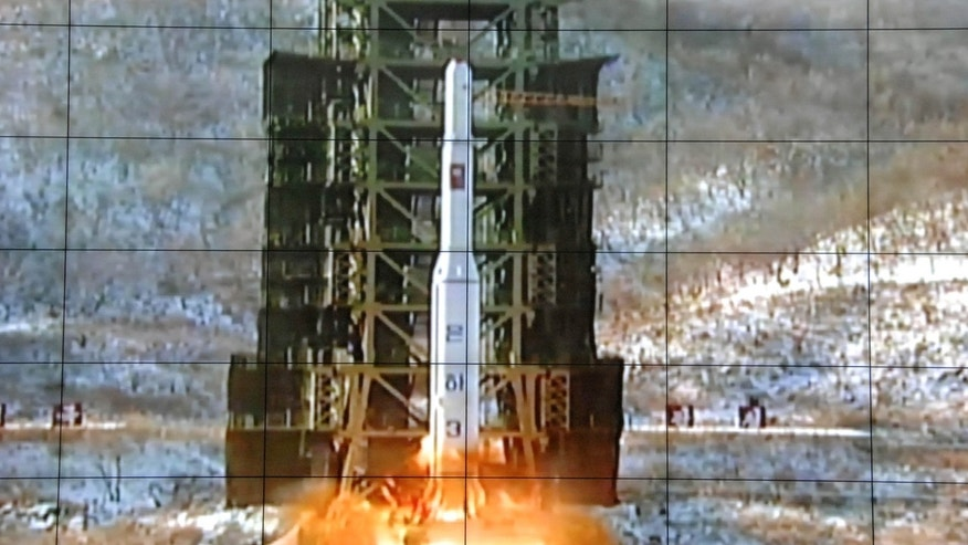 FILE - In this Dec. 12, 2012 file photo, a screen at the General Satellite Control and Command Center shows the moment North Korea's Unha-3 rocket is launched in Pyongyang, North Korea.