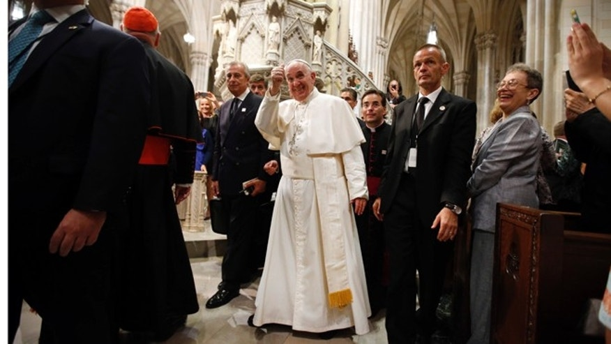 Pope Francis, center, gives a thumbs up sign after leading an evening prayer service at St. Patrick's Cathedral, Thursday, Sept. 24, 2015, in New York. (AP Photo/Jason DeCrow)