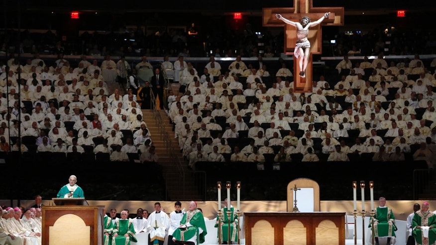 Pope Francis celebrates high Mass at Madison Square Garden in New York, Friday, Sept. 25, 2015.