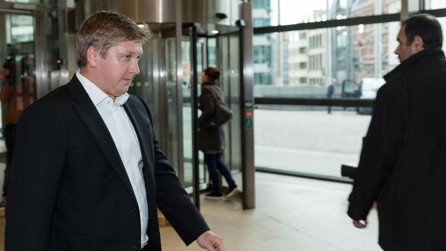 Chief Executive Officer of Naftogaz, Andriy Kobolev, left, arrives at EU headquarters in Brussels on Friday, Sept. 25, 2015.  Russia and Ukraine resumed talks on Friday in Brussels, aimed at trying to clinch a deal guaranteeing that Ukraine will receive shipments of Russian natural gas this winter. (AP Photo/Thierry Monasse)