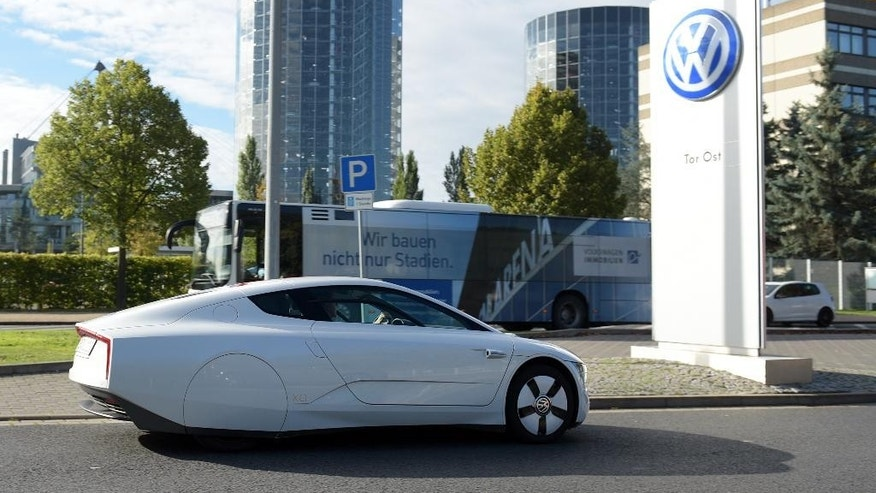 A Volkswagen XL1 enters the premises of the Volkswagen plant in Wolfsburg, Germany, Friday, Sept. 25 2015. Volkswagen's supervisory board is meeting Friday to discuss who to name as CEO after Martin Winterkorn quit the job this week over an emissions-rigging scandal that's rocking the world's top-selling automaker. (Rainer Jensen/dpa via AP)