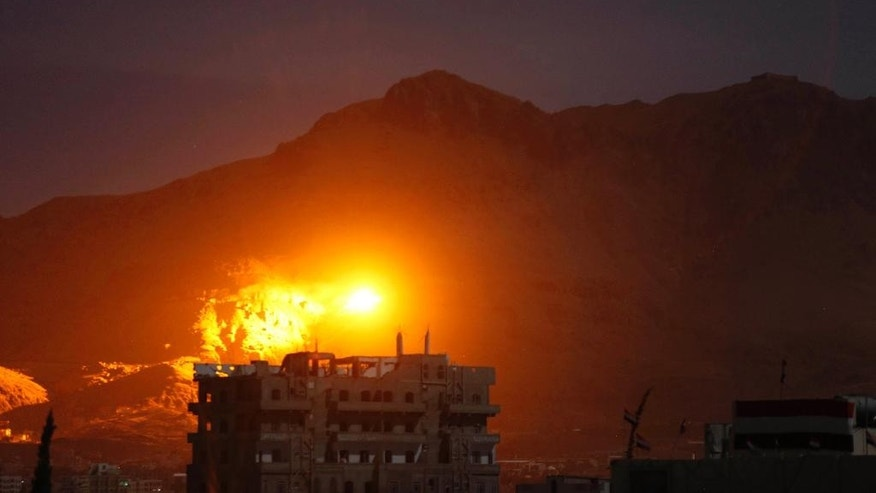 In this Thursday, Sept. 24, 2015 photo, an explosion is seen following a Saudi-led airstrike at a site believed to be one of the largest weapons depots in Sanaa, Yemen. The war in Yemen escalated in March when the Saudi-led coalition launched a campaign involving air strikes and ground troops against Shiite Houthi rebels and their allies. More than 2,100 civilians have been killed, according to U.N. estimates. The coalition recently has sought to retake rebel-held Sanaa. (AP Photo/Hani Mohammed)
