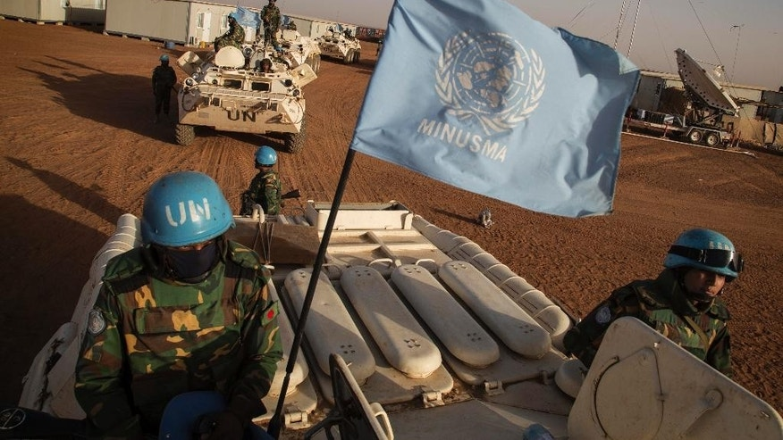 In this Feb. 25, 2015 photo provided by the United Nations, UN peacekeepers from Bangladesh arrive at the Niger Battalion Base in Ansongo, in eastern Mali. The U.N. Peacekeeping mission in Mali has become a testing ground for new approaches to peacekeeping, with the use of special forces, unarmed drones and intelligence work that brings the U.N. closer than ever to the sensitive issue of electronic surveillance. (Marco Dormino/United Nations via AP)