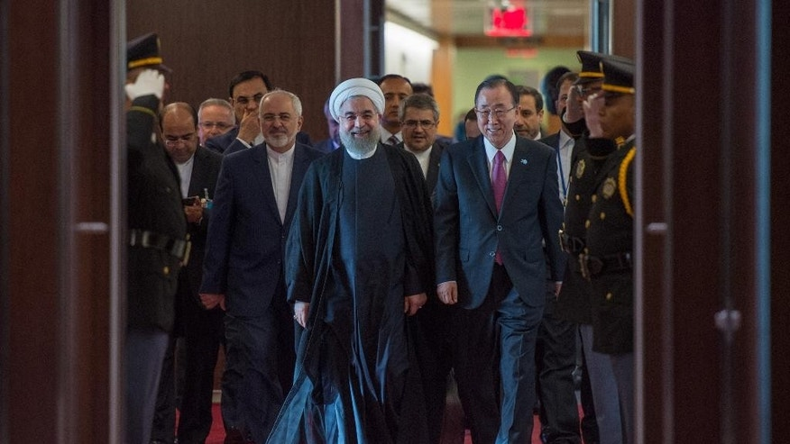 Iran's President Hassan Rouhani, left, walks with United Nations Secretary-General Ban Ki-moon, right, Saturday, Sept. 26, 2015 at United Nations headquarters. (AP Photo/Bryan R. Smith)