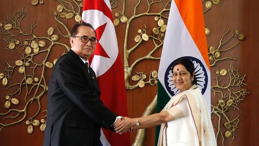 FILE – In this Monday, April 13, 2015 file photo, Indian Foreign Minister Sushma Swaraj, right, shakes hands with North Korea's Foreign Minister Ri Su Yong in New Delhi, India. Ties are warming between New Delhi and Pyongyang, with mineral-hungry India looking to boost trade while North Korea, facing sometimes-rocky relations with China, searches for new friends. The goodwill began earlier this year, when North Korea dispatched Ri on a three-day trip to India, just a few weeks before Prime Minister Narendra Modi flew to Seoul for meetings with South Korean President Park Geun-hye.  (AP Photo/Manish Swarup, File)