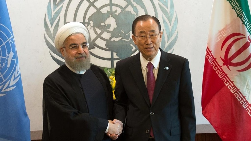 Iran's President Hassan Rouhani, left, meets United Nations Secretary-General Ban Ki-moon, right, Saturday, Sept. 26, 2015 at United Nations headquarters. (AP Photo/Bryan R. Smith)