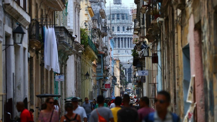 HAVANA, CUBA - SEPTEMBER 18: The National Capitol Building is pictured at the far end of a street on September 18, 2015 in Havana, Cuba. Pope Francis is due to make a three day visit to Cuba from September 19 where he will meet President Raul Castro and hold Mass in Revolution Square before travelling to Holguin, Santiago de Cuba, El Cobre and onwards to the United States. (Photo by Carl Court/Getty Images)