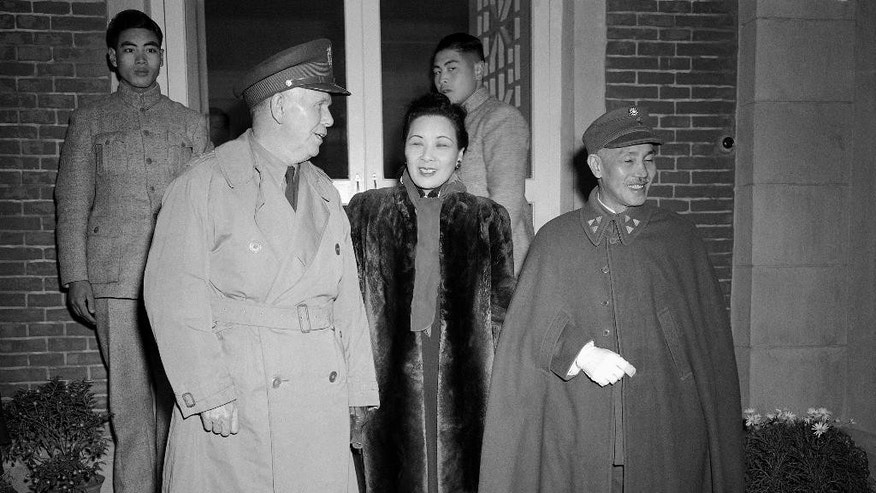 FILE - In this Dec. 22, 1945 file photo, Gen. George C. Marshall, left, special envoy of U.S. President Harry Truman to China with rank of ambassador, poses with Generalissimo Chiang Kai-Shek, right, and Madame Chiang at Chiang's Nanking home shortly after his arrival in Nanjing.  In 1945 the Republic of China, led by Chiang Kai-shek, became the first nation to sign the U.N. charter. As one of the victors in World War II, China assumed one of five permanent seats on the U.N. Security Council over the objections of some world leaders, including Britain's Winston Churchill. Chinese representatives also helped draft and sign the Universal Declaration of Human Rights. (AP Photo, File)