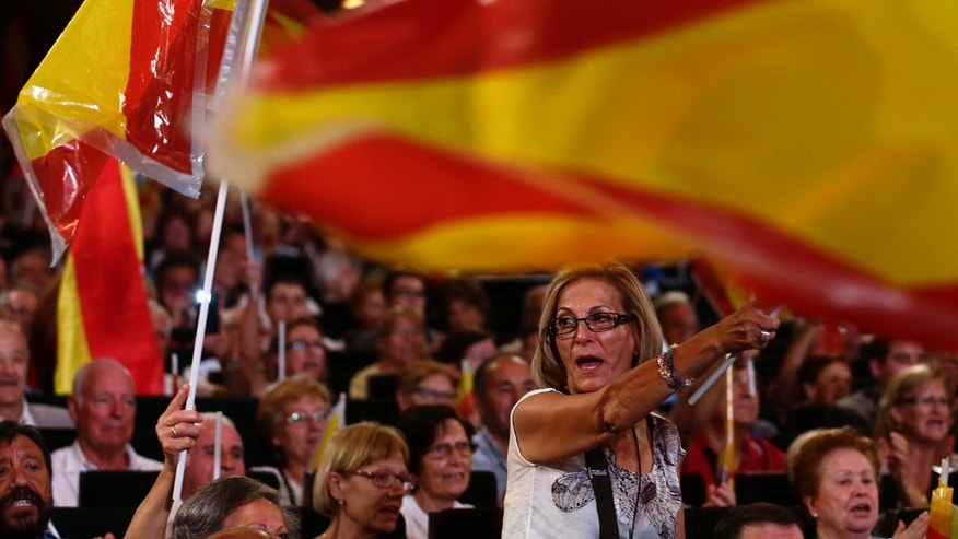 Sept. 25, 2015: People wave Spanish flags during an electoral meeting of the Popular Party of Catalonia in Barcelona, Spain.