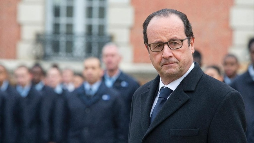 "FILE - In this Feb. 16, 2015 file photo, France's President Francois Hollande visits a public center for insertion of the Defense (EPIDE) in Montry, France. France has fired its first airstrikes in Syria as it expands military operations against Islamic State extremists, President Francois Hollande's office announced Sunday, Sept. 27, 2015. The office said that ""France has hit Syria"" based on information from French reconnaissance flights sent earlier this month. (AP Photo/Jacques Brinon/Pool, File)"