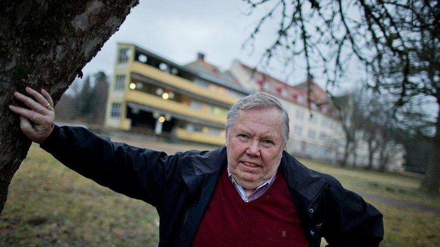 FILE- In this Dec. 19, 2013 file picture Swedish entrepreneur Bert Karlsson poses outside his refugee centre in an old sanatorium in Stora Ekeberg, near Skara, Sweden. People crammed into boats and trekking across borders have become the dominant images of Europe's migrant crisis. In the shadows, however, there are those who are profiting, among them Karlsson. (Adam Ihse/TT via AP, file)  SWEDEN OUT