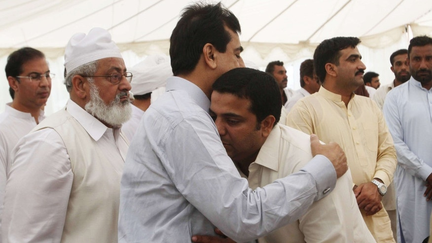 Sept. 26, 2015: A man comforts Pakistan's former Prime Minister Yousuf Raza Gillani, third from left, who lost his nephew in a crush during the Hajj pilgrimage in Saudi Arabia.