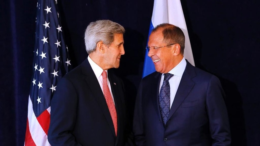 U.S. Secretary of State John Kerry, left, meets with Russian Foreign Minister Sergey Lavrov, Sunday, Sept. 27, 2015, in New York. (AP Photo/Jason DeCrow)