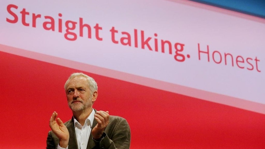 Britain's Labour party leader, Jeremy Corbyn, applauds during the party's annual conference in Brighton, southern England, Sunday Sept. 27, 2015. For six decades, British governments have considered unilateral nuclear disarmament unthinkable — but the once-unthinkable is the Labour Party's new normal. Britain's main opposition party has just elected a leader from the radical left, and this week party members may commit a future Labour government to scrapping Britain's Trident nuclear arms program. (Gareth Fuller/PA Via AP)  UNITED KINGDOM OUT  NO SALES  NO ARCHIVE