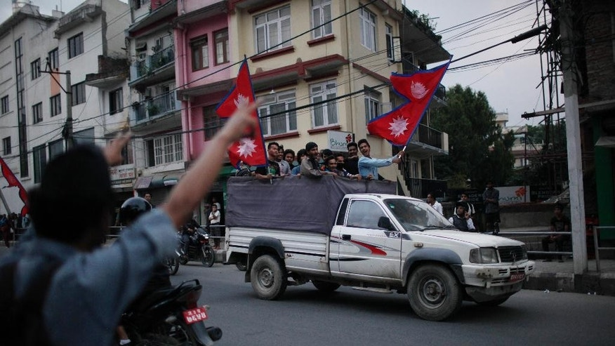 Students affiliated with Communist Party of Nepal (Unified Marxist–Leninist), arrive near the Indian Embassy for a protest against the blockade of cargo trucks along the border with India in Kathmandu, Nepal, Sunday, Sept. 27, 2015. Nepal started imposing restrictions on vehicular movement Sunday as a blockade of cargo trucks along the border with India has badly hit the supplies of essential commodities, especially fuel. (AP Photo/Niranjan Shrestha)