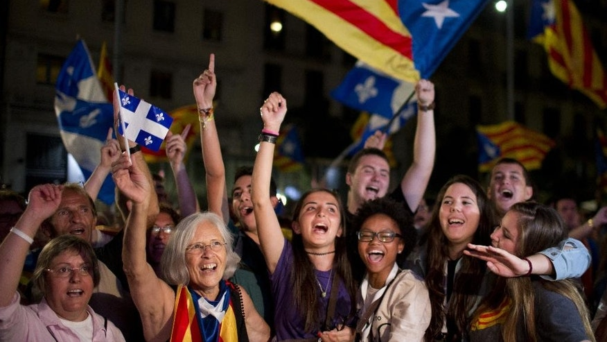 Catalonian pro-independence supporters celebrate in Barcelona, Spain, Sunday Sept. 27, 2015. Voters in Catalonia participated in an election Sunday that could propel the northeastern region toward independence from the rest of Spain or quell secessionism for years. (AP Photo/Emilio Morenatti)