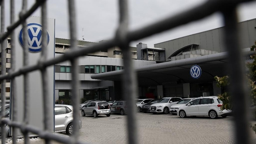 Cars are parked in a Volkswagen dealer in Milan, Italy, Sunday, Sept. 27, 2015. German media report that Volkswagen received warnings years ago about the use of illegal tricks to defeat emissions tests. The automaker admitted last week that it used special software to fool U.S. emissions tests for its diesel vehicles. (AP Photo/Luca Bruno)