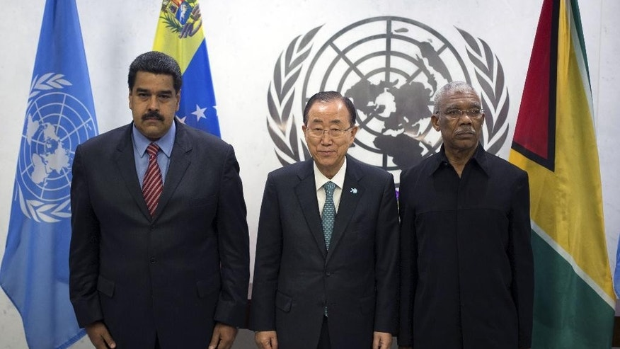 United Nations Secretary-General Ban Ki-moon, center, poses with Venezuelan President Nicolas Maduro Moros, left, and Guyanese President David Arthur Granger at the United Nations headquarters Sunday, Sept. 27, 2015. (AP Photo/Kevin Hagen)