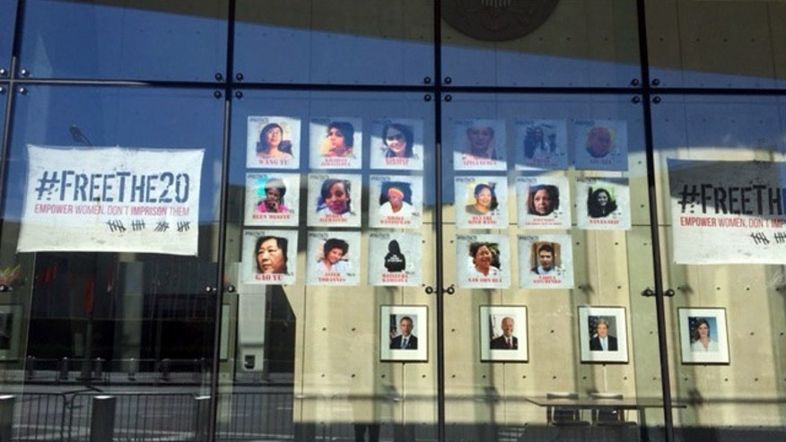 In this undated photo provided by the United States Mission to the United Nations, 16 photos of imprisoned female activists join a silhouette representing a 17th woman, in the window of the United States Mission to the United Nations in New York. In the period leading up to a high-level U.N. meeting Sunday to promote women's equality on Sunday, Sept. 27, 2015, U.S. Ambassador Samantha Power has put the photos of 20 women activists in the window of the U.S. Mission across the street from U.N. headquarters. She said the women should be at Sunday's meeting, not in jail. (Kurtis A. Cooper/U.S. Department of State via AP)