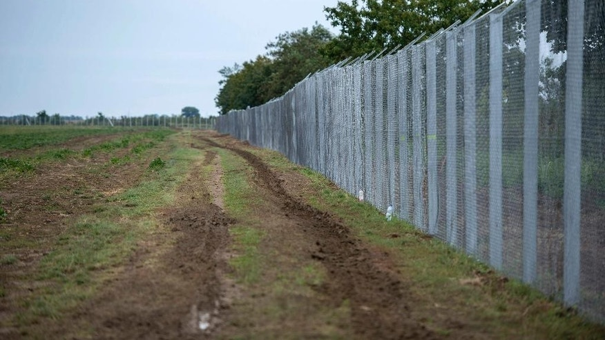 A part of the temporary fence sits at the border crossing between Hungary and Croatia at Beremend, 237 kms south of Budapest, Hungary, Monday, Sept. 28, 2015. (Tamas Soki/MTI via AP)