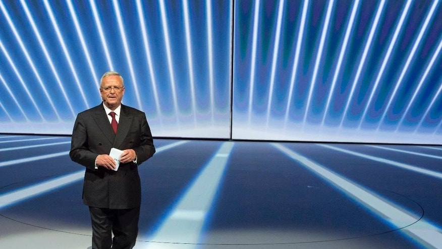 FILE - In this Sept. 14, 2015 file photo Volkswagen CEO Martin Winterkorn, center, leaves the stage during the Volkswagen group night on the eve of the Frankfurt Auto Show IAA in Frankfurt, Germany. German prosecutors said Monday, Sept. 28, 2015 they open investigation into former Volkswagen CEO Martin Winterkorn. (AP Photo/Jens Meyer)